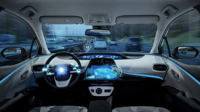 empty cockpit of vehicle, HUD(Head Up Display) and digital speedometer. autonomous car. driverless car. self-driving vehicle.