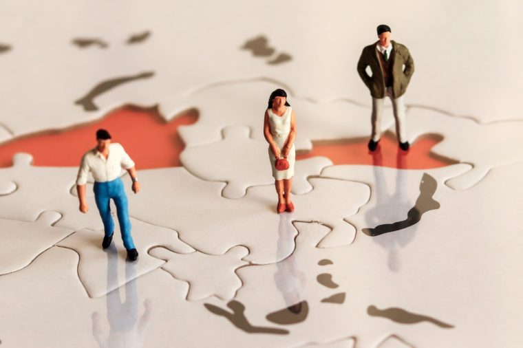 World maps and miniature people
