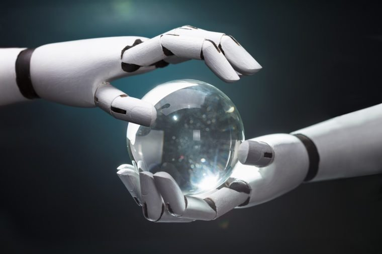 Close-up Of A Robot's Hand Predicting Future With Crystal Ball