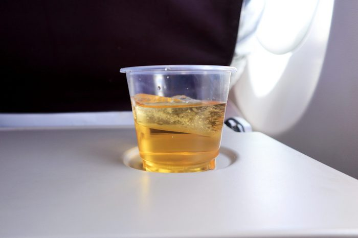 Close up the Apple Juice on Airplane Table