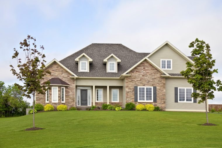 A new home with a landscaped yard.