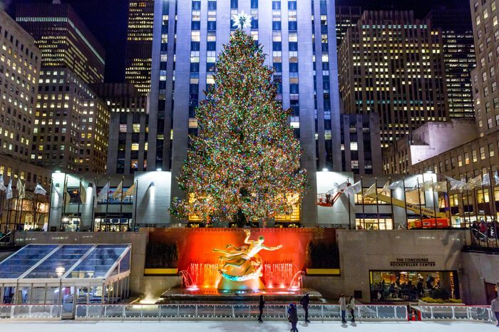 New York City, New York/United States - January 7, 2015: A brightly illuminated Rockefeller Plaza with a Christmas tree.