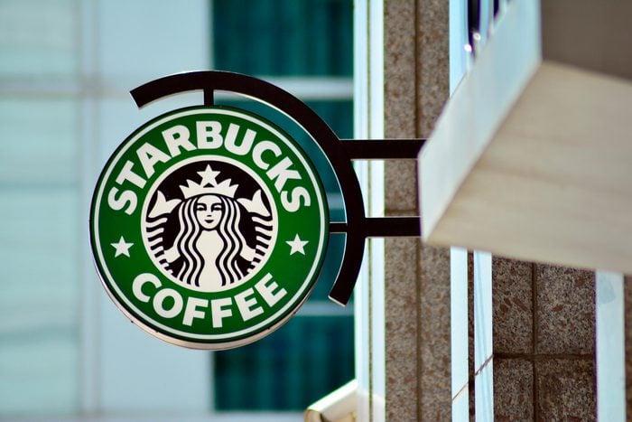 close up on starbucks coffee sign