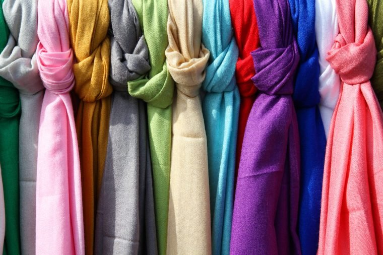 Colorful scarves at a market in Italy. Colors of textiles.