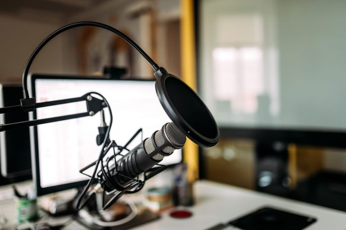 Podcast studio, microphone and computer.