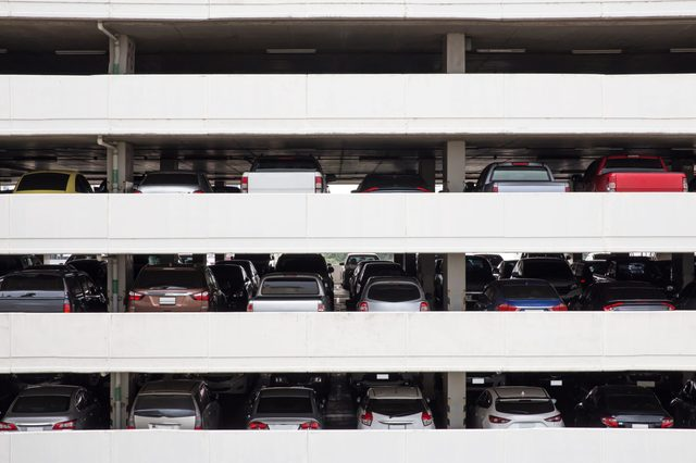 Building Parking Deck Levels and rows in high building in the city .view from the opposite parking garage