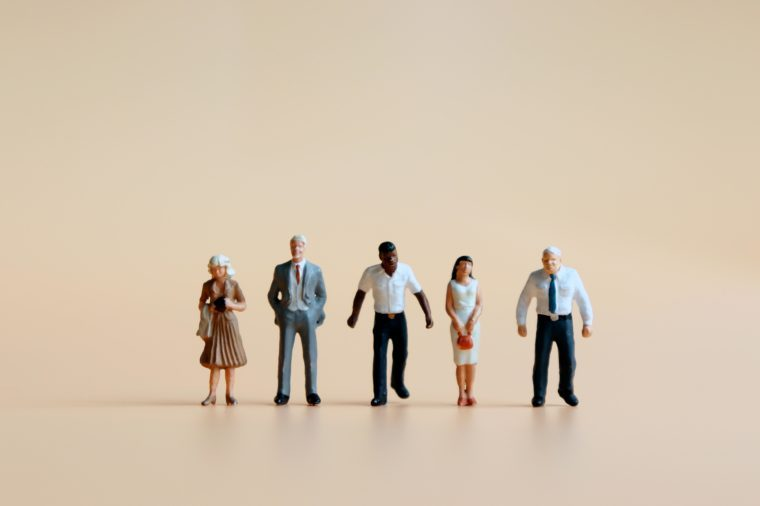 Various miniature people standing side by side.