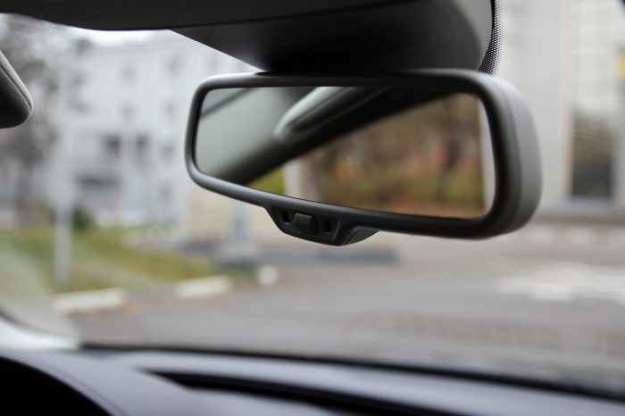 Rearview mirror on the windshield of the car