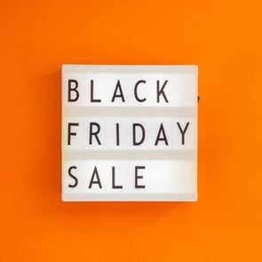 Creative Top view flat lay promotion composition Black friday sale text on lightbox alarm clock orange background copy space Template Black friday sale mockup fall thanksgiving promotion advertising; Shutterstock ID 1230044665; Job (TFH, TOH, RD, BNB, CWM, CM): RD