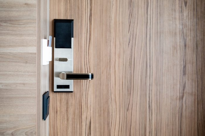 Electronic card smart lock on wooden door at the hotel for power