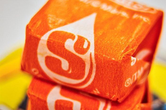 Close up of orange flavored starburst fruit candy