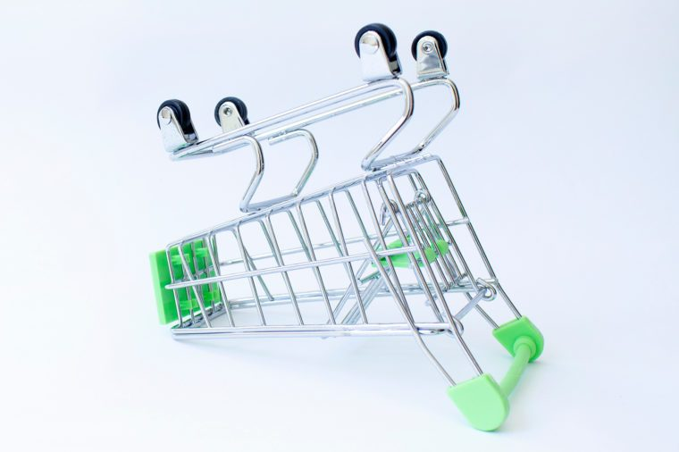 Empty shopping consumer store supermarket cart upside down on white background