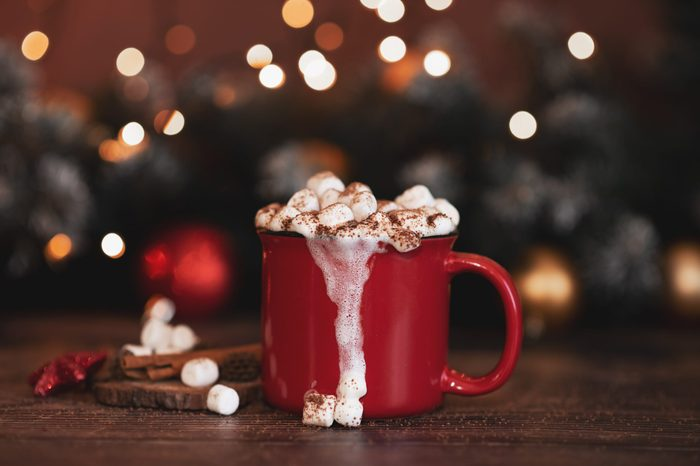 Red mugs with hot chocolate and marshmallows. Christmas concept