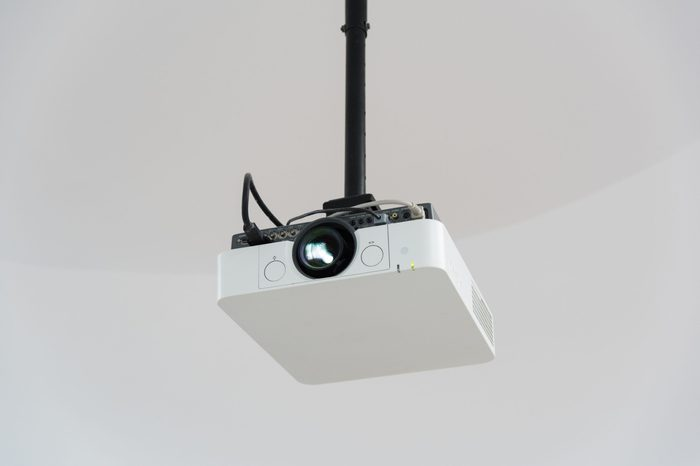 Close-up of white projector hanging from the roof
