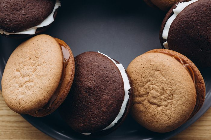 Close up Traditional chocolate and Pumpkin Whoopie pies made with vanilla cream cheese. Background for bakeries, cafes, restaurants
