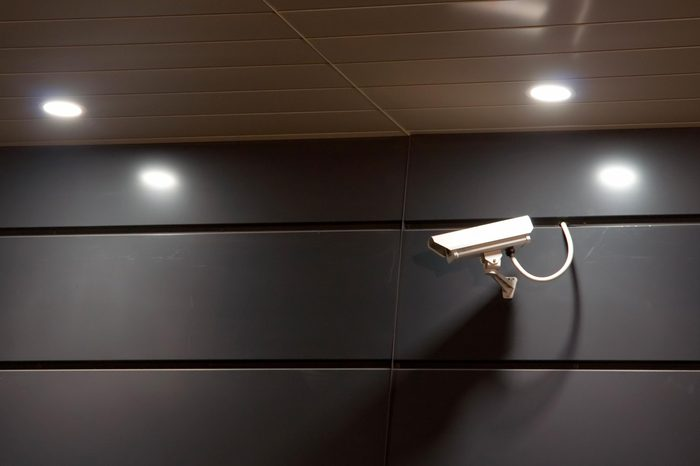 security camera on a wall at night