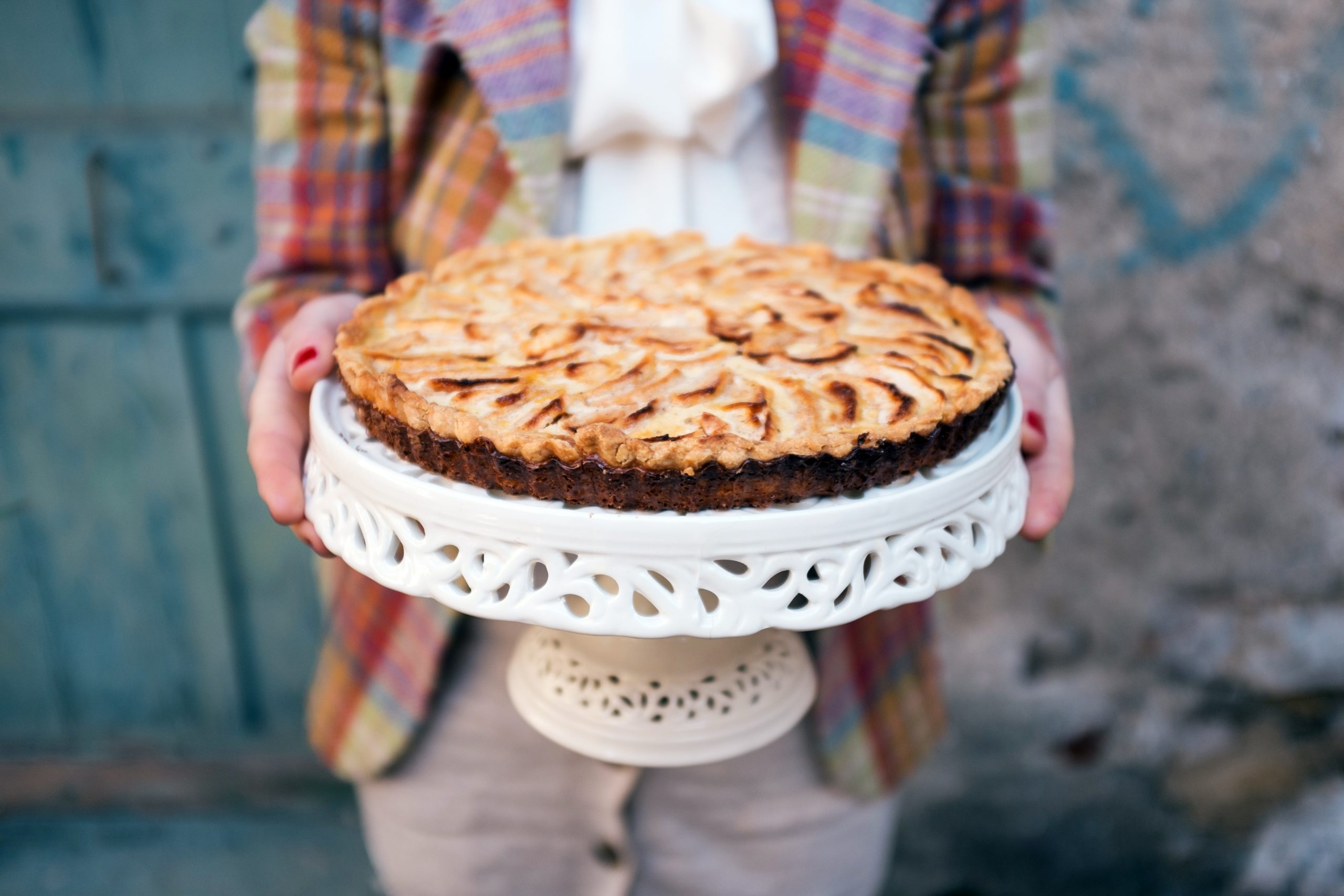 Women in vintage clothes holding apple pie