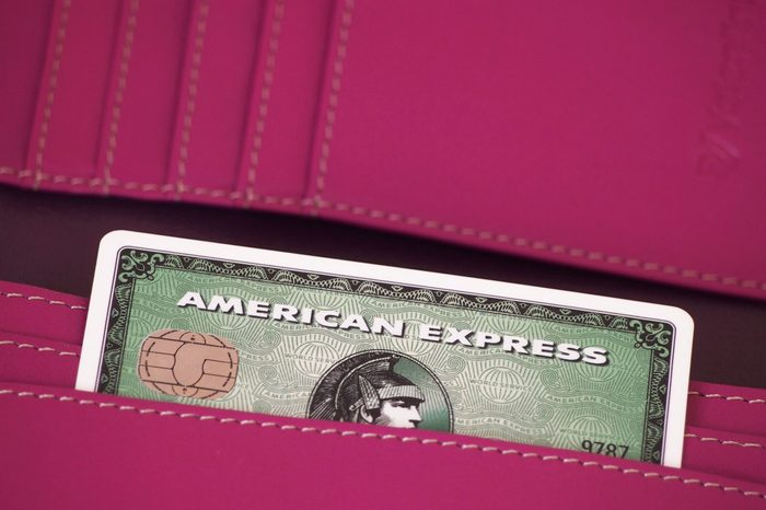 ZAGREB, CROATIA - MARCH 22, 2014: Photo of green American express card in wallet. American express is one of most popular credit cards worldwide.; Shutterstock ID 183400619; Job (TFH, TOH, RD, BNB, CWM, CM): RD
