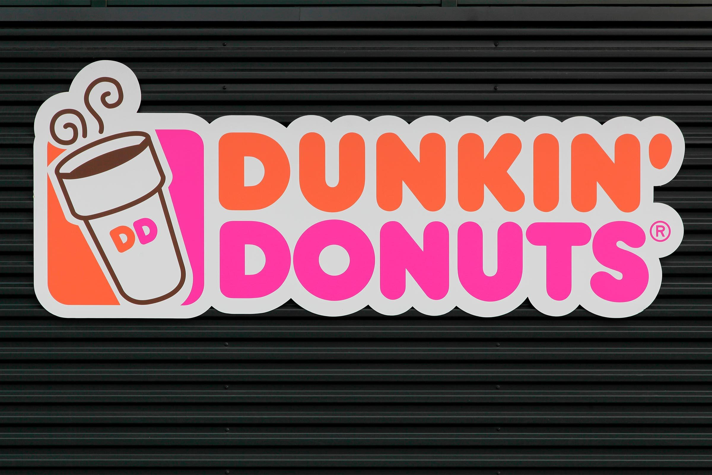 Dunkin' Donuts sign on a wall.