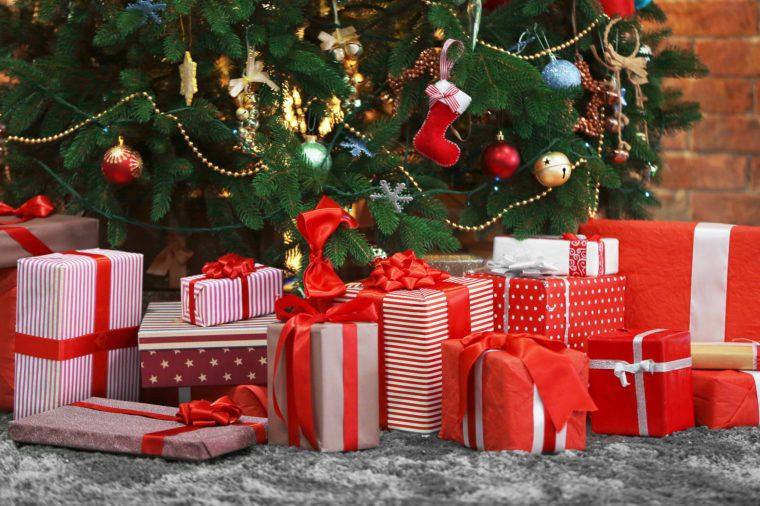 Presents under the Christmas tree on floor