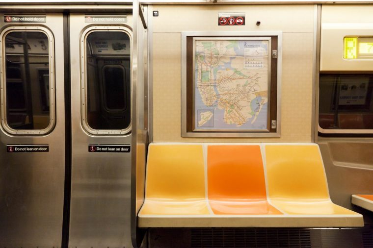 New York, NY, USA - March 11, 2016: Inside of subway wagon: Colorful seats and inside of empty car: The NYC Subway is one of the oldest and most extensive public transportation systems in the world.