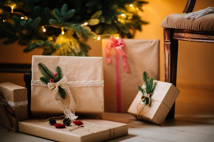 beautiful Christmas gifts under tree in new year decorated house interior