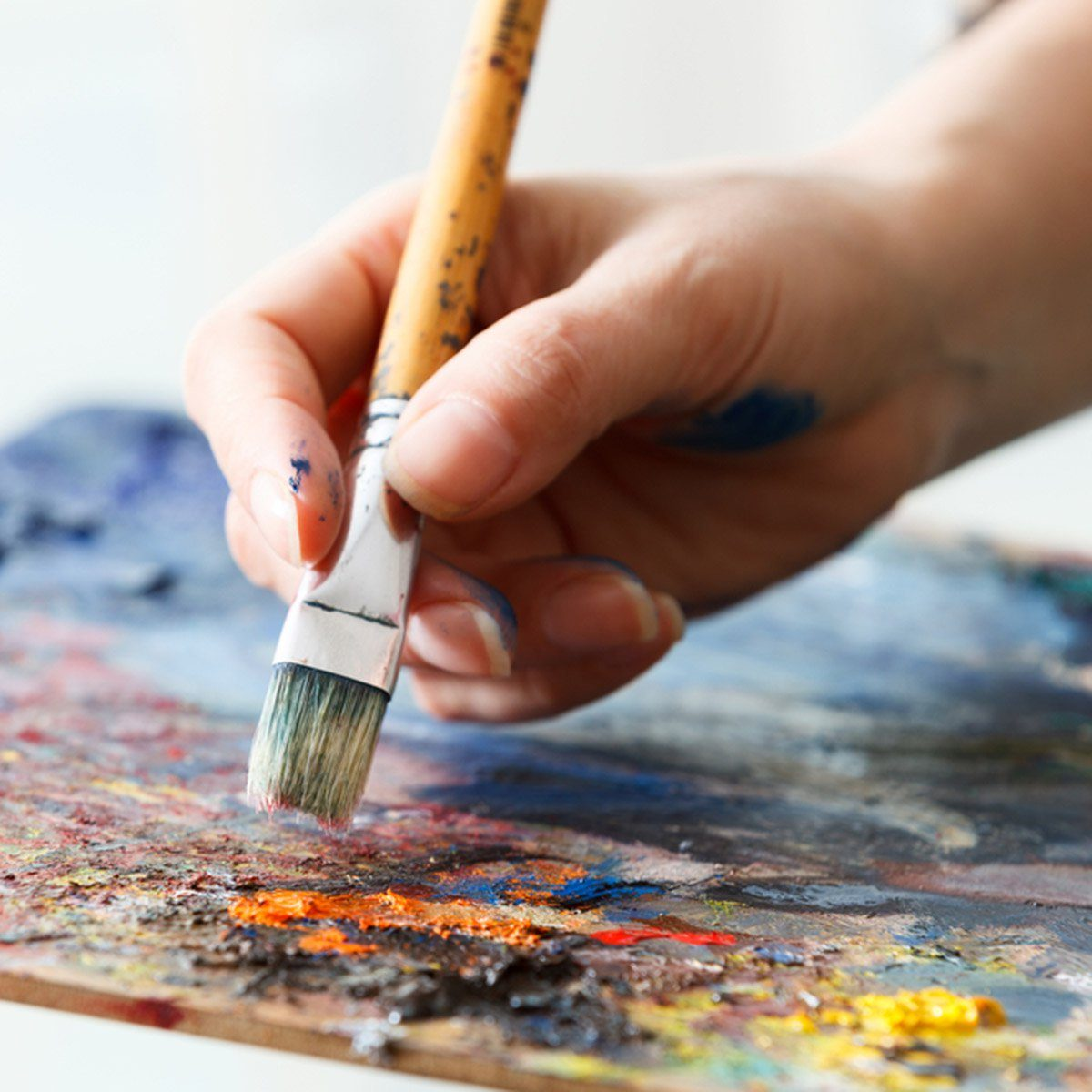 Artist paints a picture of oil paint brush in hand with palette close up.; Shutterstock ID 528643702; Job (TFH, TOH, RD, BNB, CWM, CM): Taste of Home