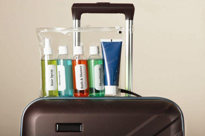 travel liquids and suitcase