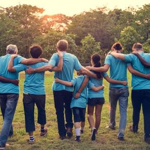 Group of diversity people volunteer arm around