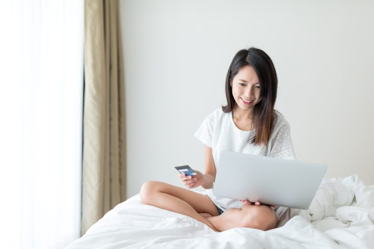 Woman shopping online with laptop computer and credit card