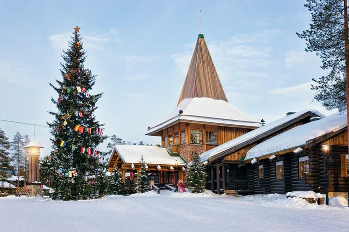 Santa Claus Office in Santa Village with Christmas tree, Lapland, Finland, on Arctic Circle in winter. People on the background