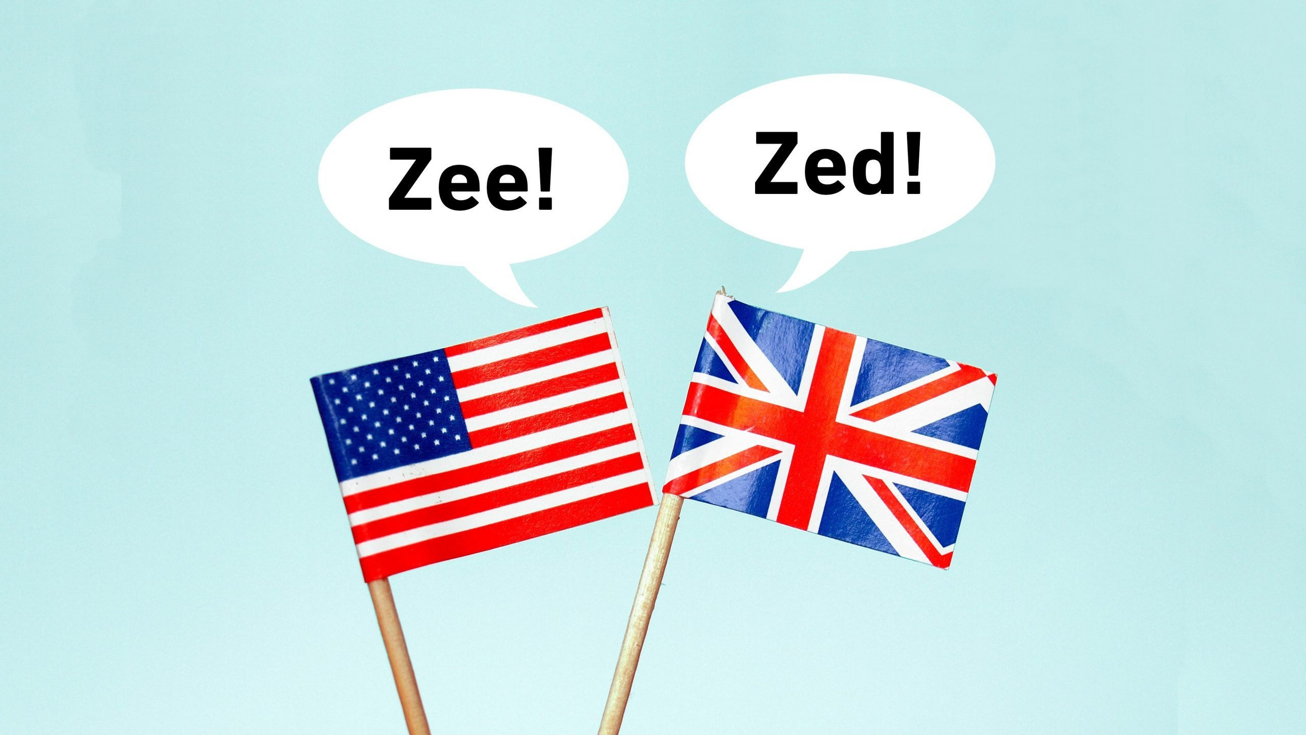 "The national flag of the United Kingdom (UK) with a speech bubble that reads ""zed!"" and the flag of the United States of America (USA) with a speech bubble that reads ""zee!"""