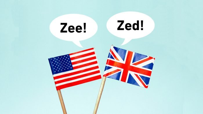 """The national flag of the United Kingdom (UK) with a speech bubble that reads """"zed!"""" and the flag of the United States of America (USA) with a speech bubble that reads """"zee!"""""""