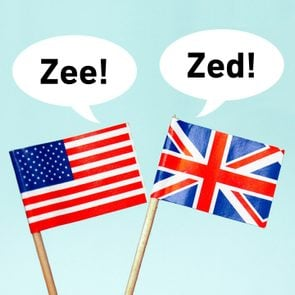 The national flag of the United Kingdom (UK) with a speech bubble that reads