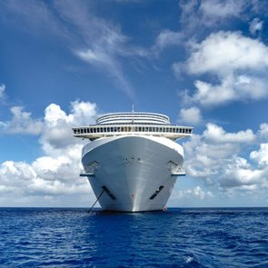 Cruise ship in crystal blue water with blue sky