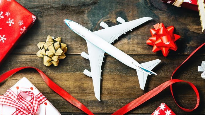 Flat lay of Merry Christmas and Happy new year and any holidy travel concept. Traveling Christmas and Happy new year greeting card concept background with copy space top view.