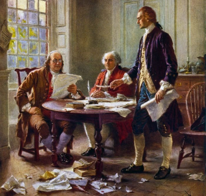 Mandatory Credit: Photo by Everett/Shutterstock (10410401a) American Revolution, Second Continential Congress, Philadelphia, 1775-1776. Delegates of the Drafting Committee at work on the Declaration of Independence, 1776. L-R: Benjamin Franklin, and John Adams, worked with Thomas Jefferson at his lodgings, on the corner of Seventh and High (now Market St.) streets in Philadelphia