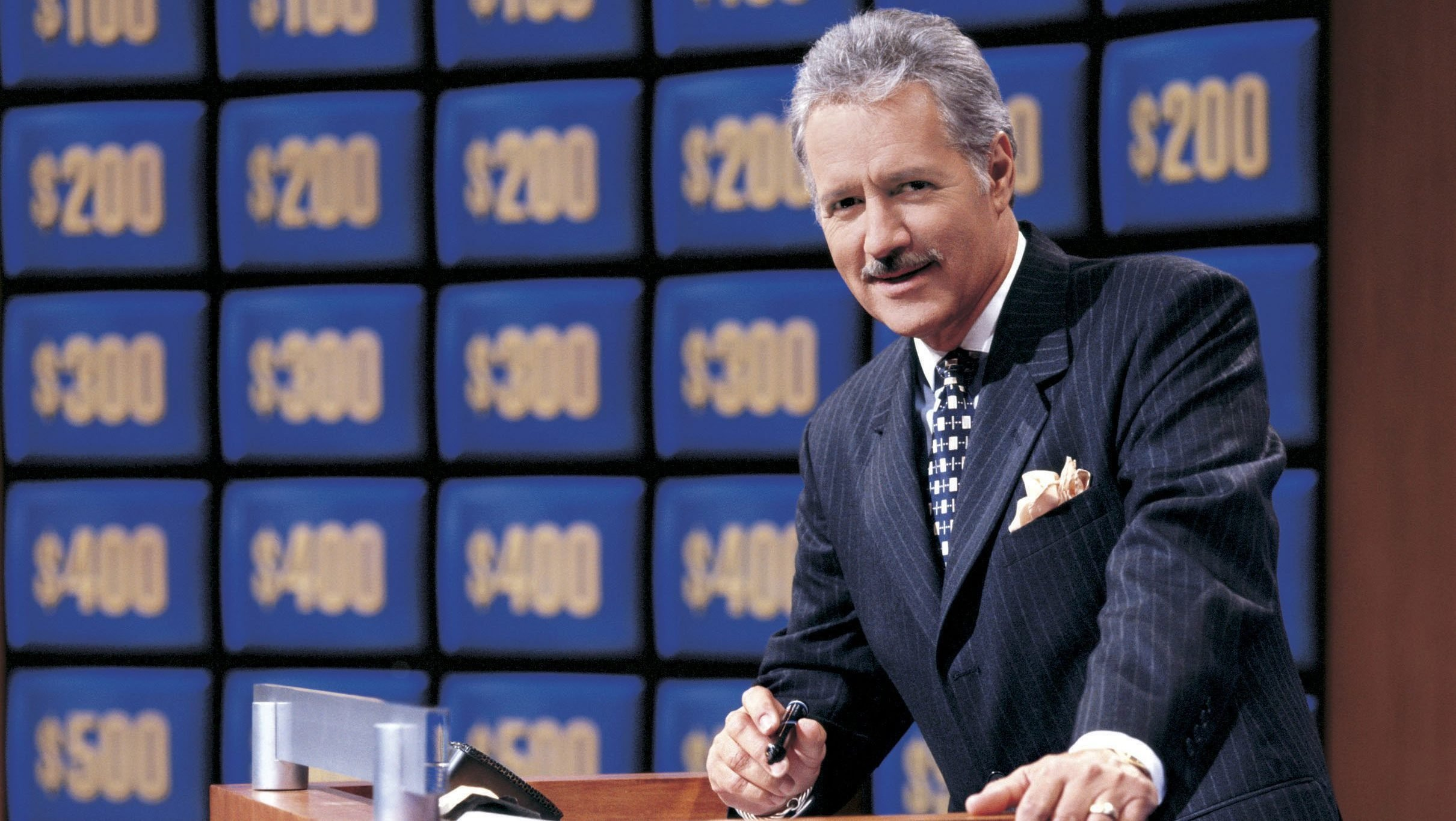 Why Alex Trebek Has a Bounced Check Framed on His Wall