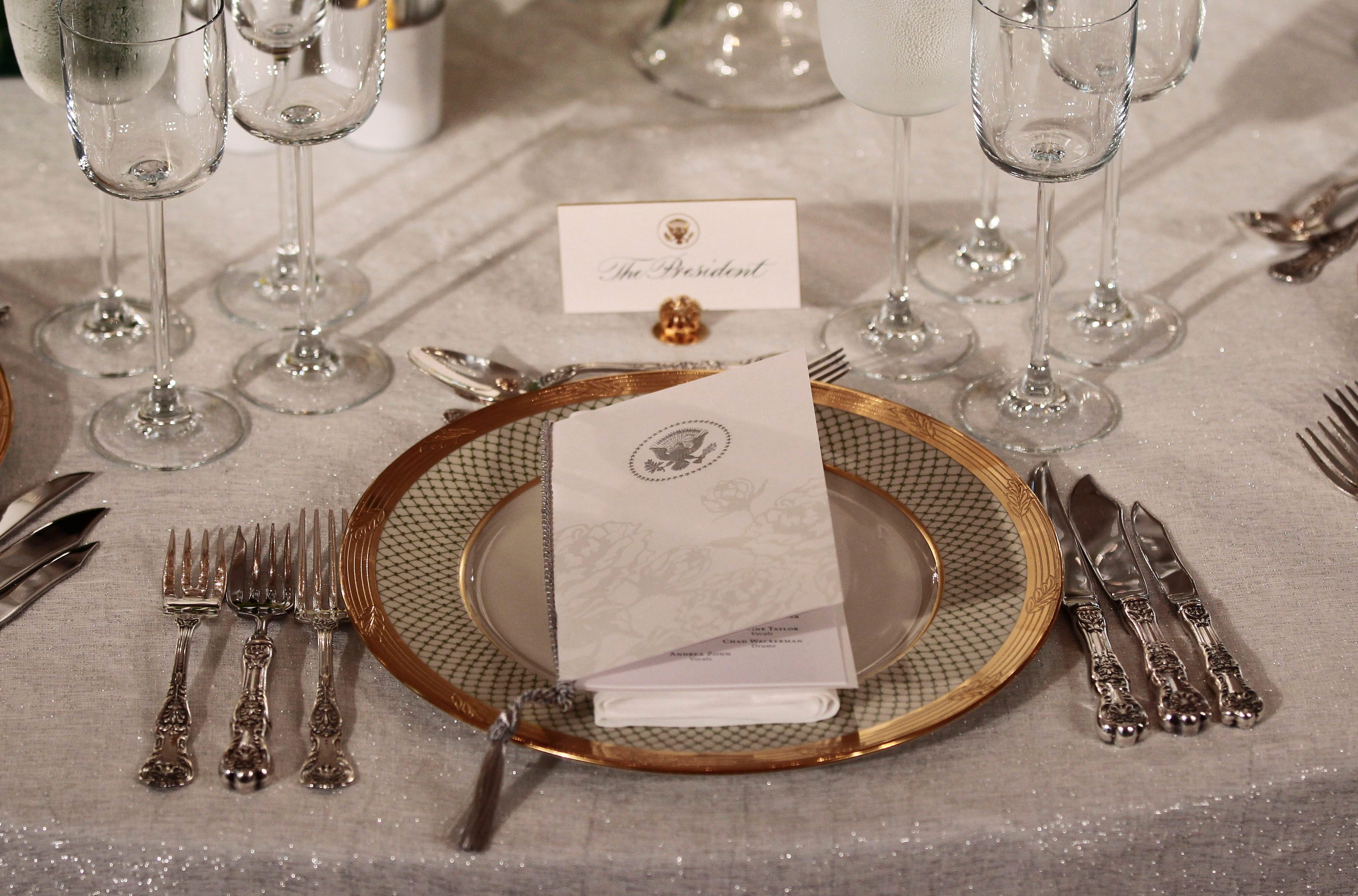 Mandatory Credit: Photo by Pablo Martinez Monsivais/AP/Shutterstock (5943225am) A place setting for the State Dinner in honor of German Chancellor Angela Merkel is seen during a preview for members of the media, in the State Dining Room of the White House in Washington Obama US Germany, Washington, USA