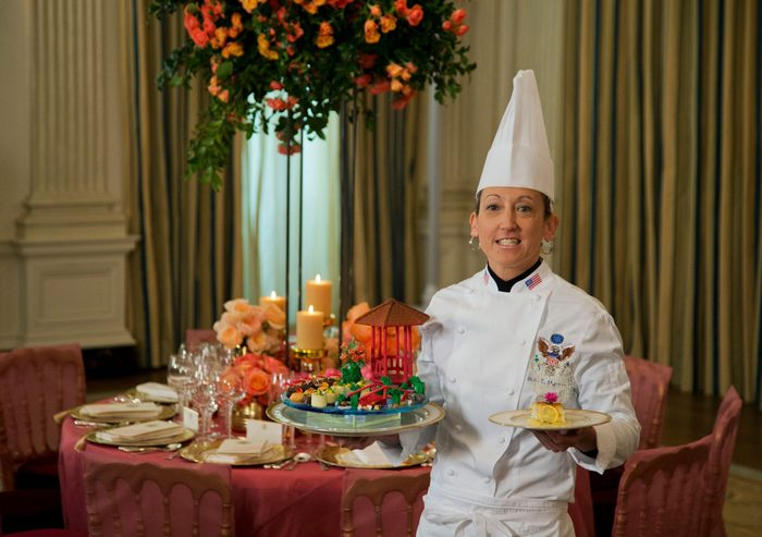 """Mandatory Credit: Photo by Manuel Balce Ceneta/AP/Shutterstock (6010918a) Susie Morrison White House Executive Pastry Chef, Susie Morrison, shows the dessert called """"a stroll through the garden"""" and a lightly buttered artisanal bread accented with a delicate egg custard including a Meyer lemon curd and lychee sorbet, during a preview in the State Dining Room of White House in Washington, for the state dinner of the visiting Chinese President Xi Jinping. It will be Colorado lamb on the menu and Grammy-winning R&B singer Ne-Yo as the entertainment, when President Barack Obama welcomes Chinese President Xi Jinping to the White House for a state dinner on Friday State Dinner China Redo, Washington, USA"""