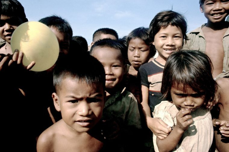 Cambodian refugees at Wat Nhu Lai (temple) on route 5, just north of Phnom Penh on . Soup kitchen there is administered by Catholic relief services 7 Mar 1975