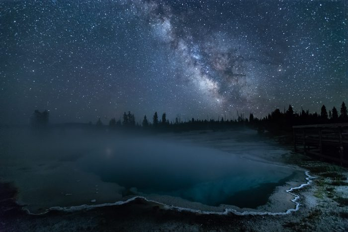 This is the picture of Black Pool at night with mikyway and stars at Yellowstone National Park, Idaho, USA.