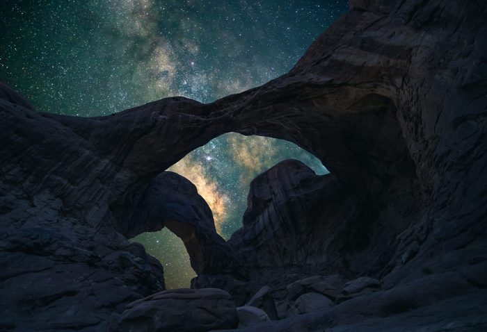 Double Arch in Arches National Park in Utah under the night sky.