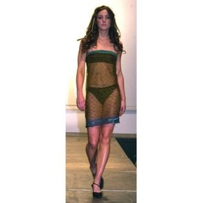 Mandatory Credit: Photo by Malcolm Clarke/Daily Mail/Shutterstock (984523a) Kate Middleton on the catwalk wearing a sheer black lace dress over a bandeau bra and black bikini bottoms St Andrews University Charity Fashion Show, Scotland, Britain - 26 Mar 2002 Kate Middleton, 19, a friend of Prince William at the university wearing a sheer black lace dress over a bandeau bra and black bikini bottoms. She is believed to be one of his future flatmates in his second year.