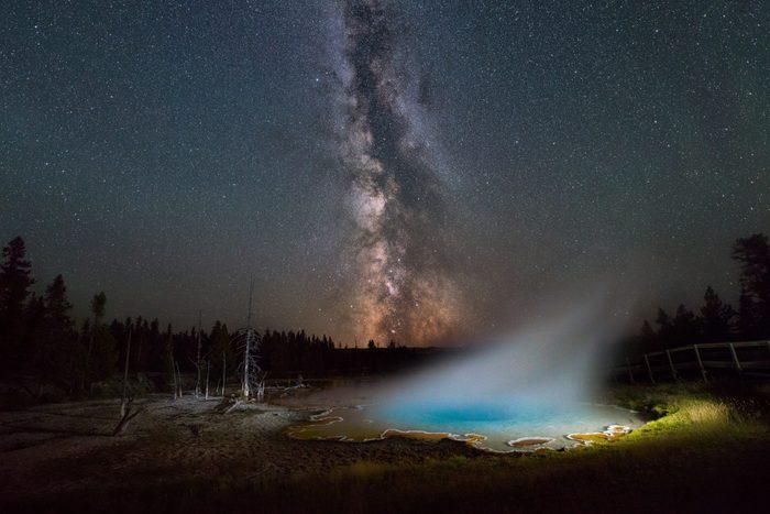 Silex Spring, Yellowstone National Park under the night sky.