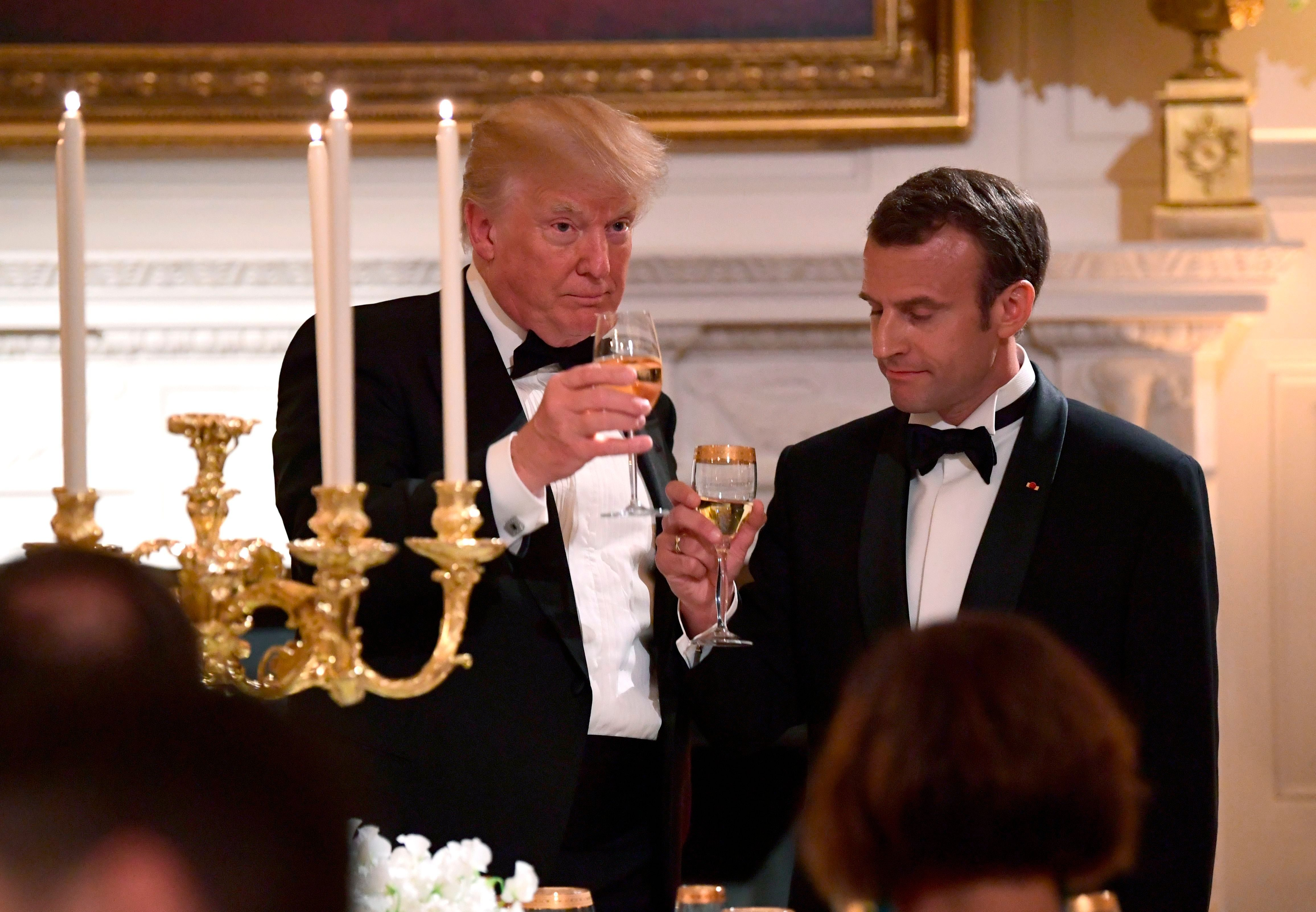 Mandatory Credit: Photo by Susan Walsh/AP/Shutterstock (9641564j) President Donald Trump and French President Emmanuel Macron toast in the State Dining Room during a State Dinner at the White House in Washington Trump US France, Washington, USA - 24 Apr 2018