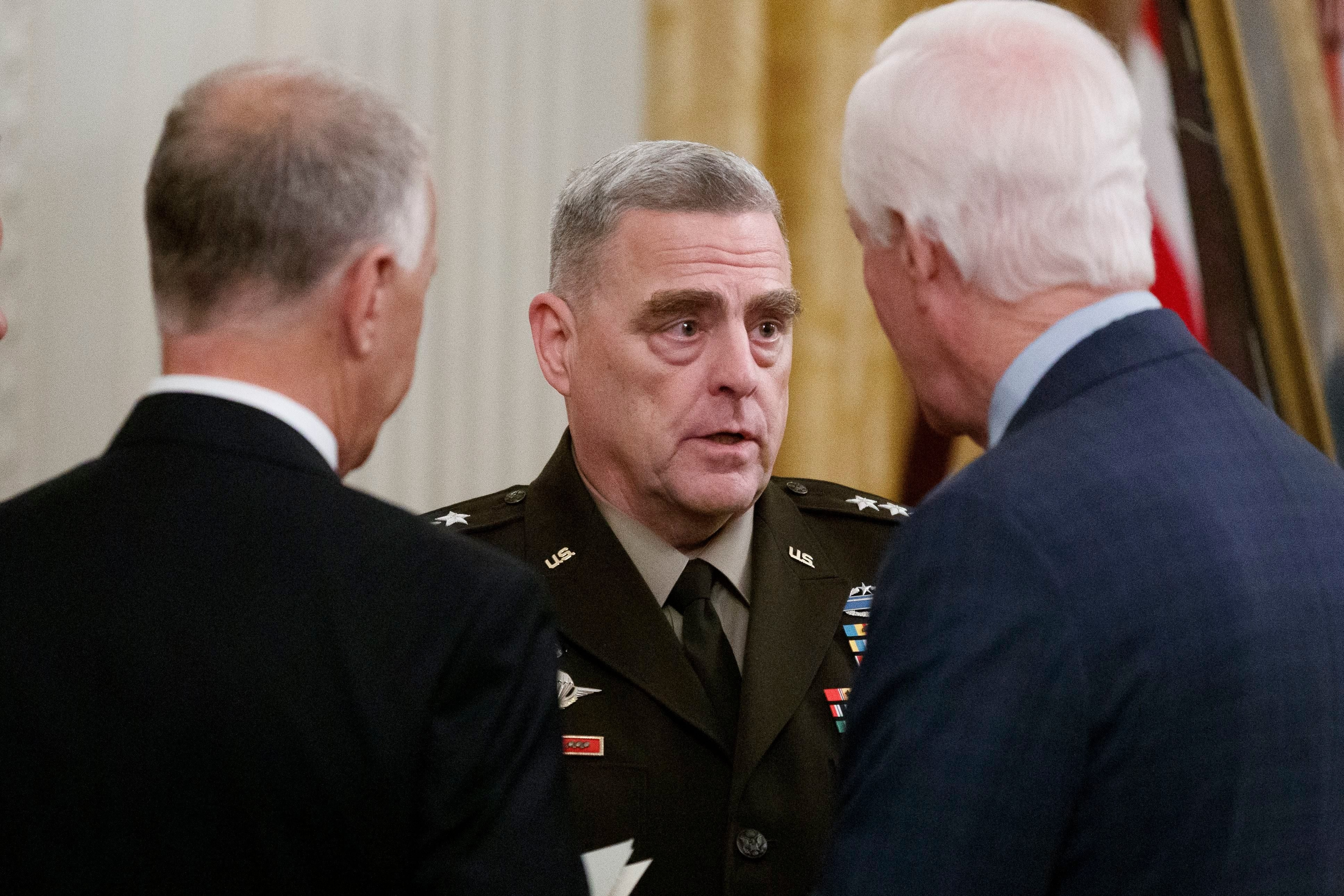Mandatory Credit: Photo by Alex Brandon/AP/Shutterstock (10461265d) Sen. Thom Tillis, R-N.C., left, Joint Chiefs Chairman Gen. Mike Milley, and Sen. John Cornyn, R-Texas, talk before for a Medal of Honor Ceremony for U.S. Army Master Sgt. Matthew Williams, currently assigned to the 3rd Special Forces Group, in the East Room of the White House, in Washington Trump, Washington, USA - 30 Oct 2019