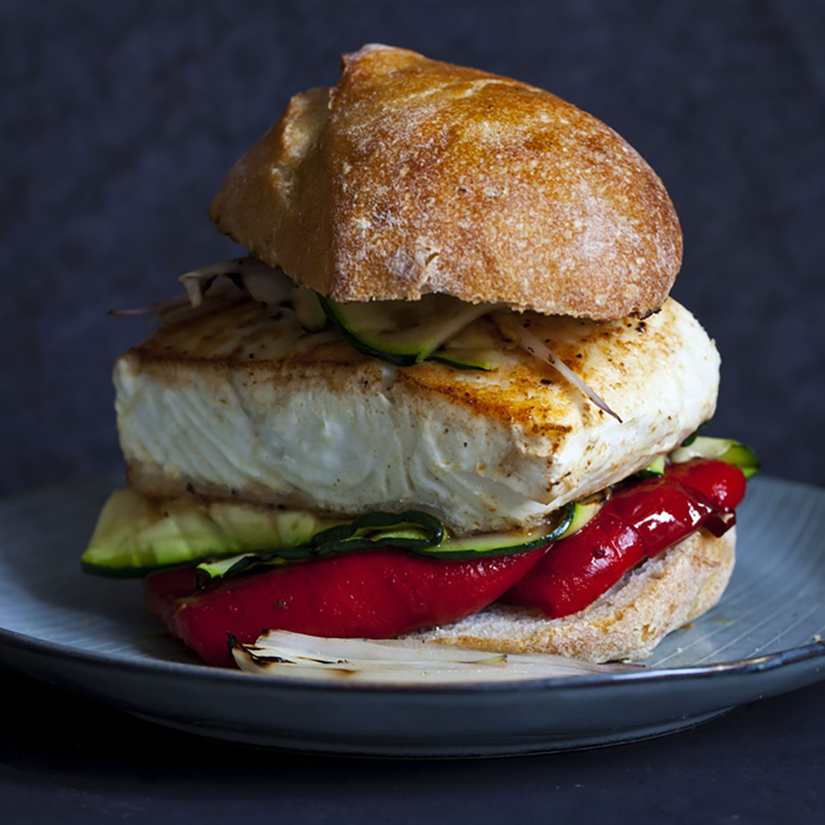 Grilled halibut sandwich with courgettes and red pepper