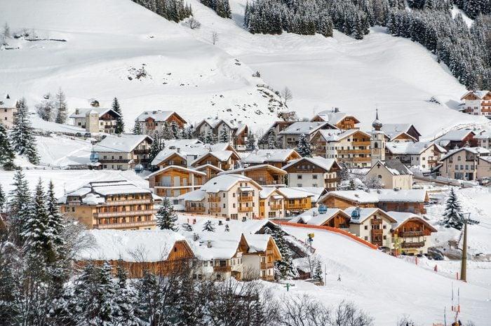 Cloudy view of Dolomites near Canazei of Val di Fassa, Trentino-Alto-Adige region, Italy.