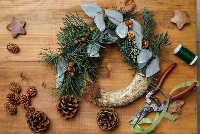 Top down view of florist's worktable. Making of Christmas wreath. Copy space - perfect for a festive card.